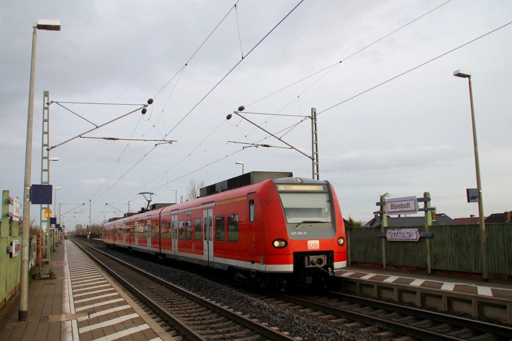 Auf dem gegengreis hält 425 264 am Haltepunkt Fürstadt, aufgenommen am 21.11.2015.